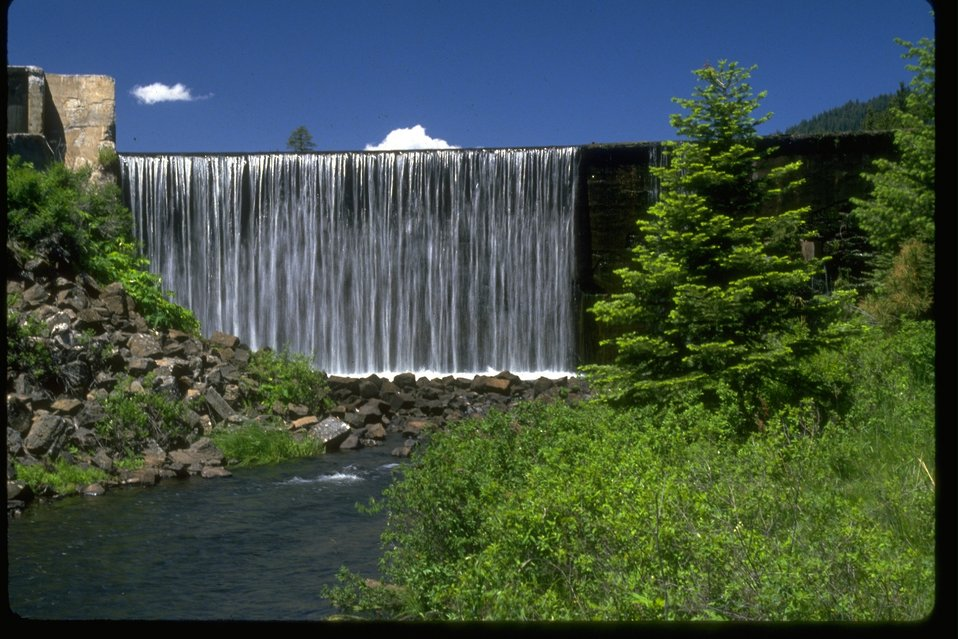 Water flows over the top of the Little Hyatt Dam.