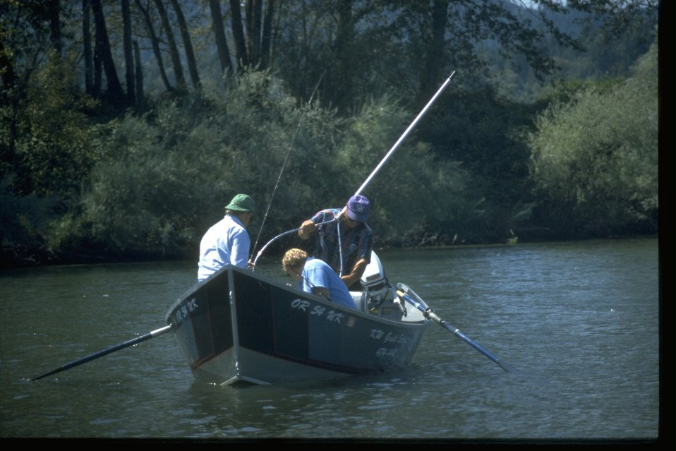 Fishing from small fishing boat on the Rogue River.