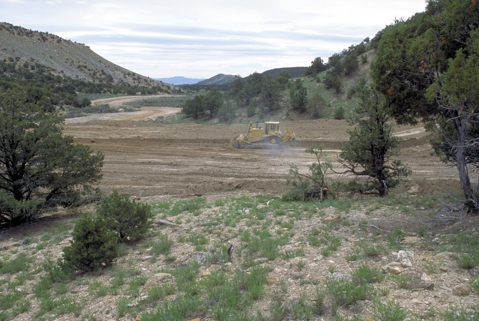 Building a drill pad for coal bed methane production near price, Utah.