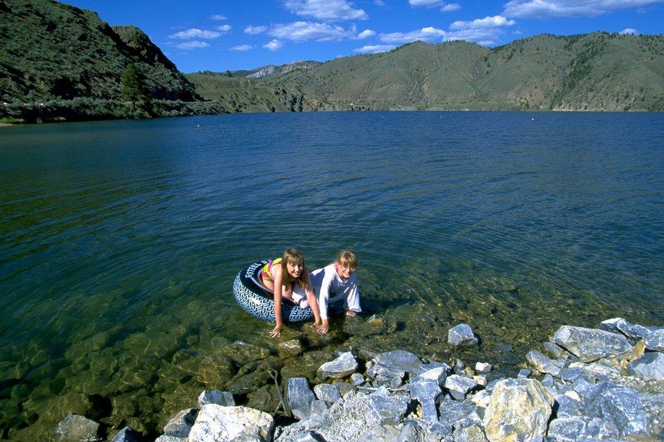 Girls coming ashore from playing in Hauser Lake