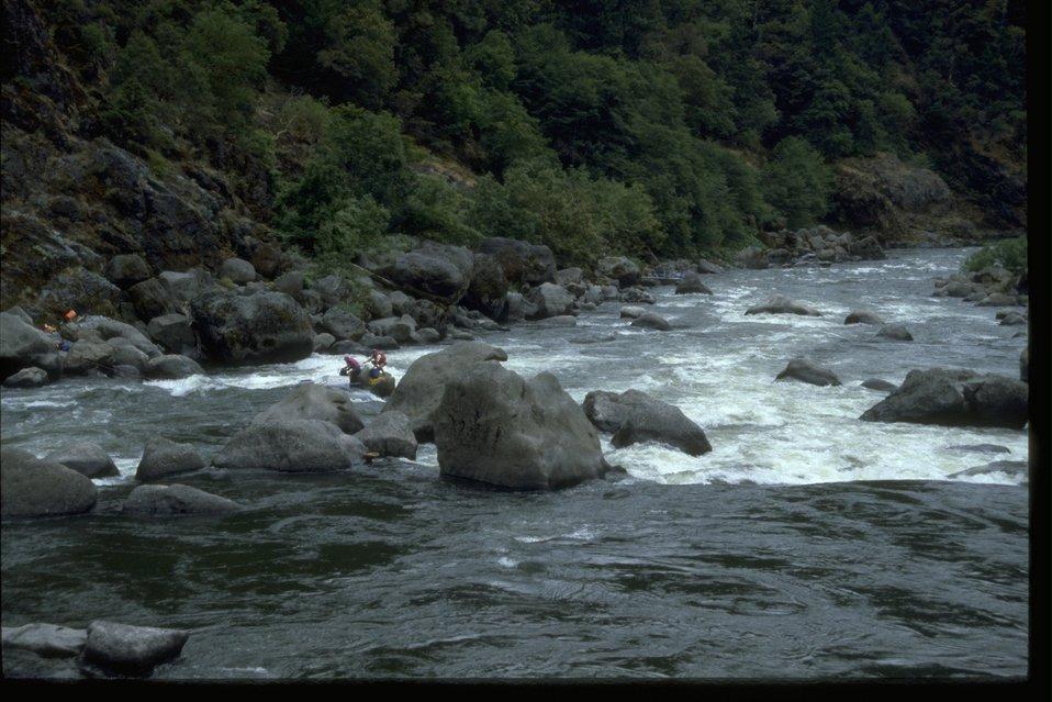 Raft stuck at Blossom Bar at Rainie Falls on the Rainie River.