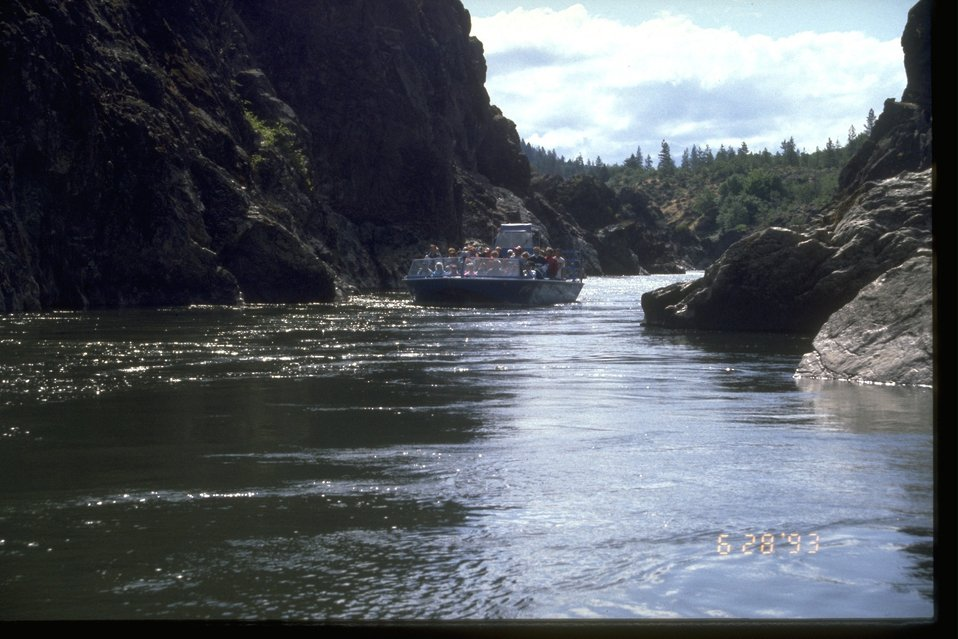 Large tourist jet boat in Hellgate Canyon on the Rogue River.