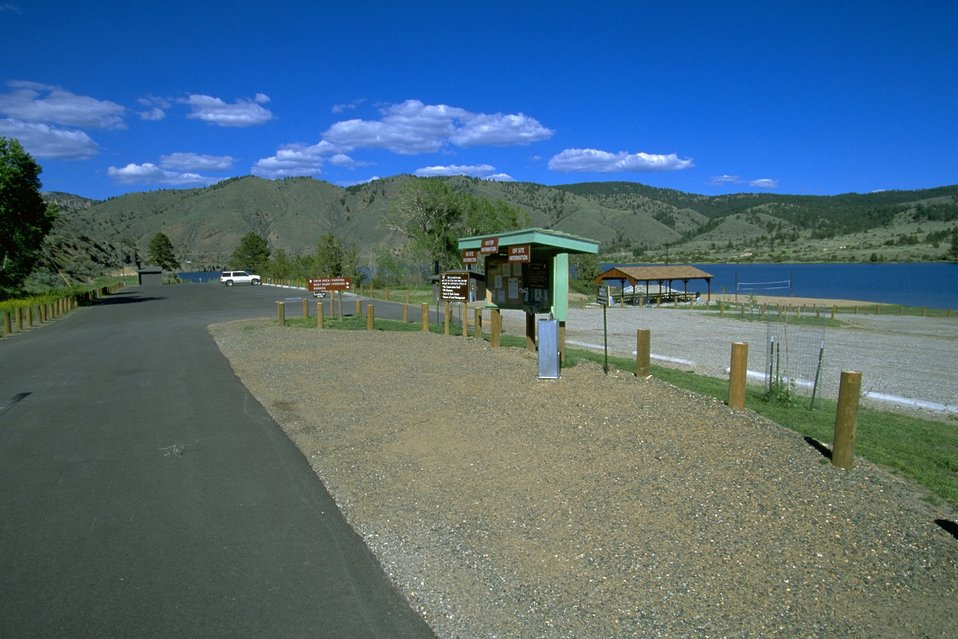 Parking Area and Kiosk at the Clark's Bay Day Use Area by Hauser Lake