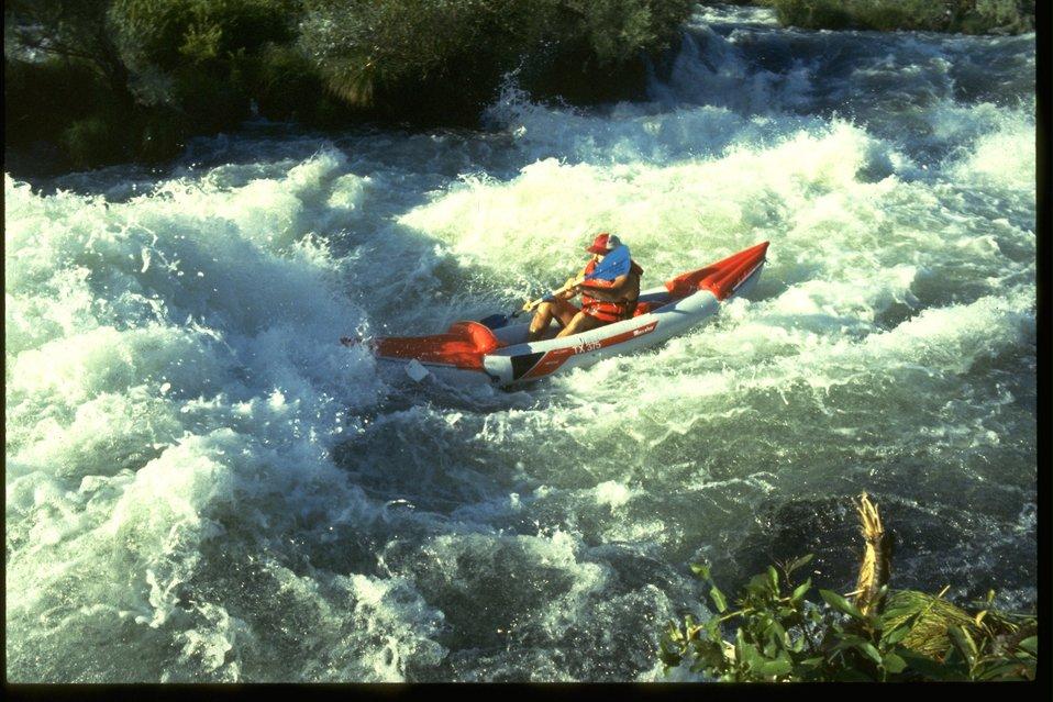 Kayaker at Nugget Falls on the Rogue River.