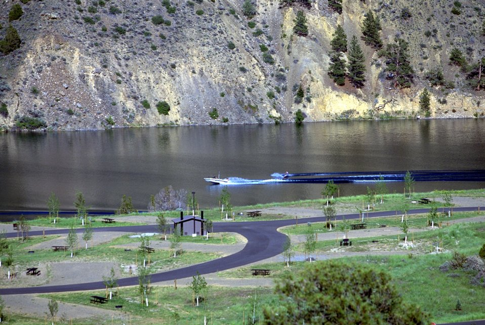 View of Devils Elbow Campground and water skier on Hauser Lake