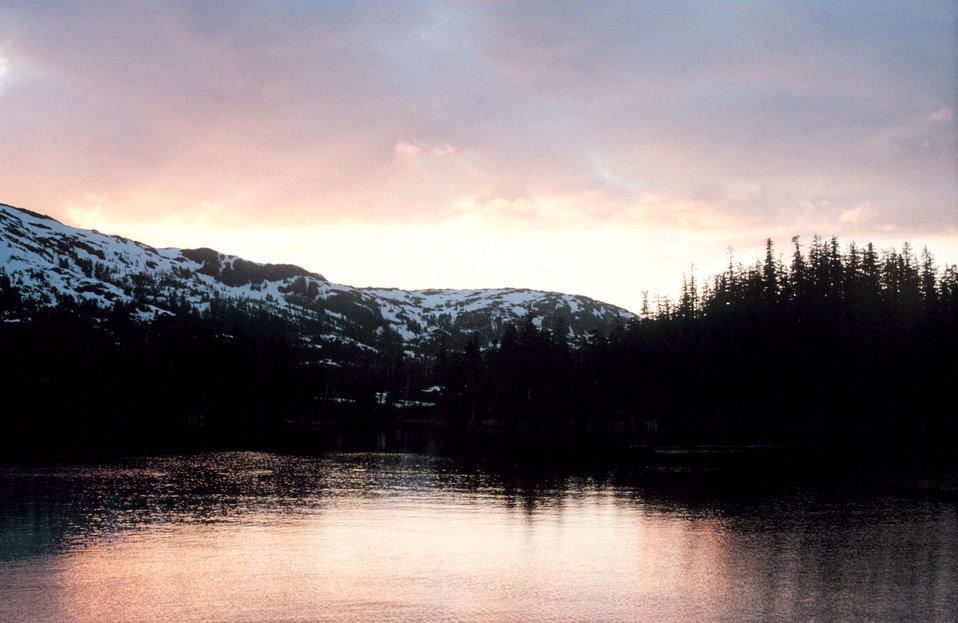 Sunset illuminating a quiet cove in Southeast Alaska.