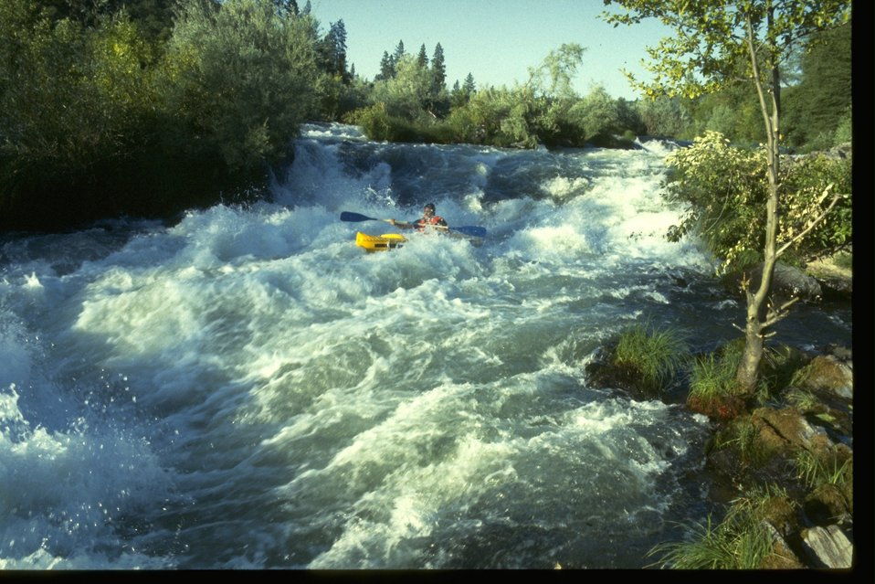 Kayaking on the whitewater rapids of Nugget Falls on the Rogue River.