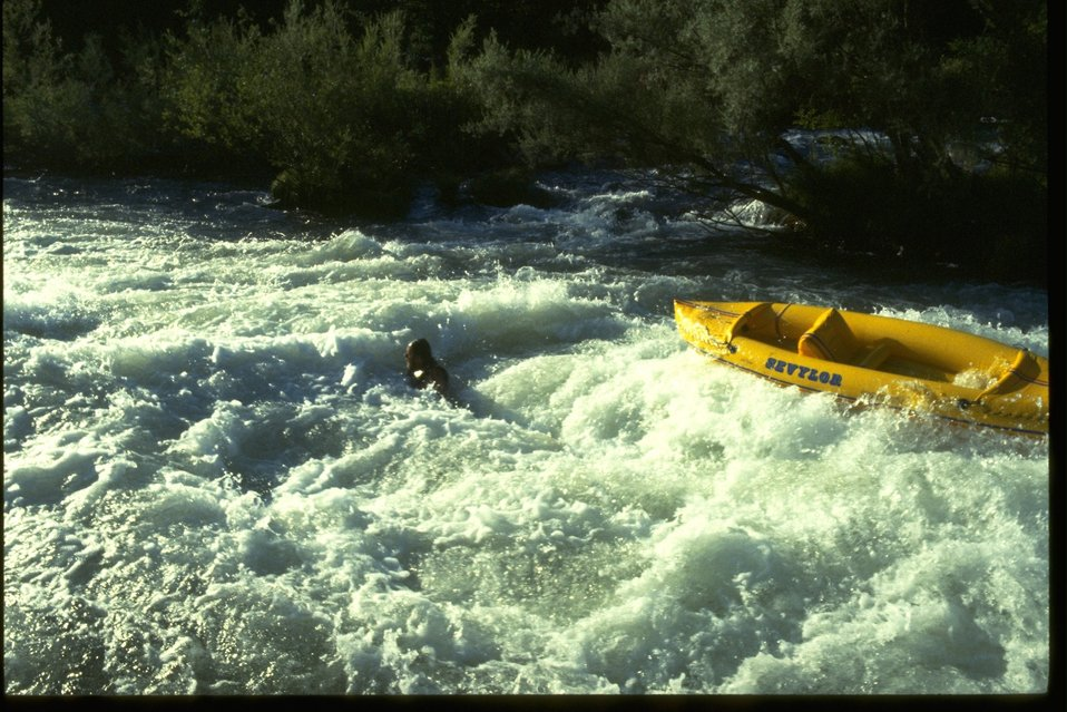 MAN OVERBOARD--Kayaking on the whitewater rapids of Nugget Falls on the Rogue River.