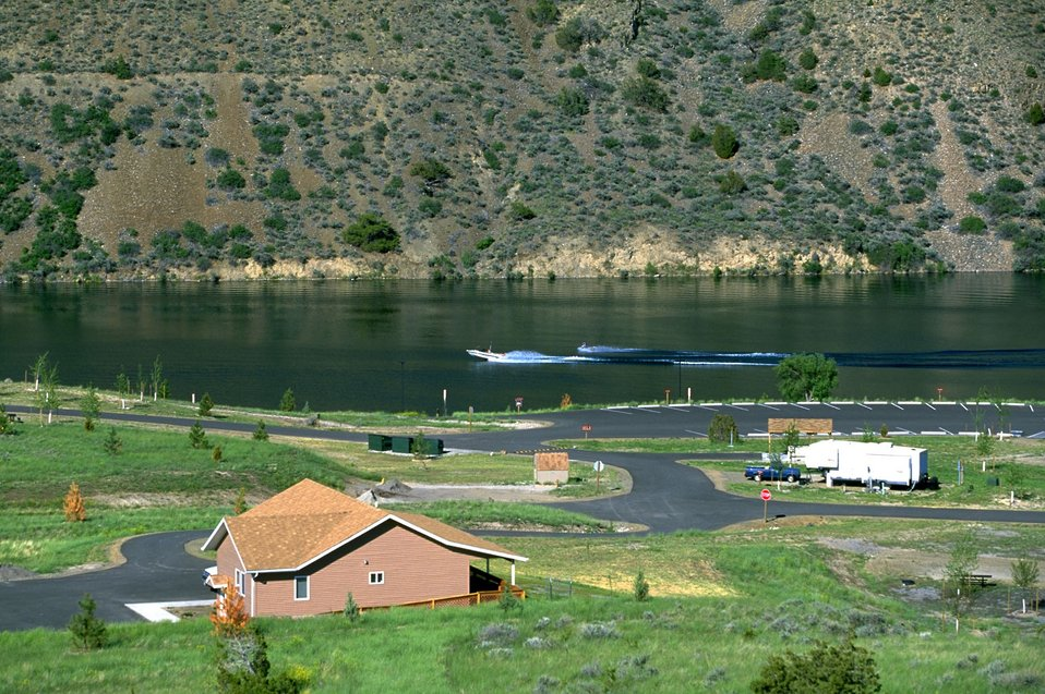 Devils Elbow Campground on Hauser Lake with view of administration building and water skier