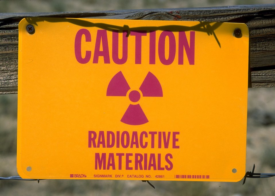 Caution sign posted concerning radioactive materials at Gas Hill Abandoned Mine Lands, Lander Field Office.