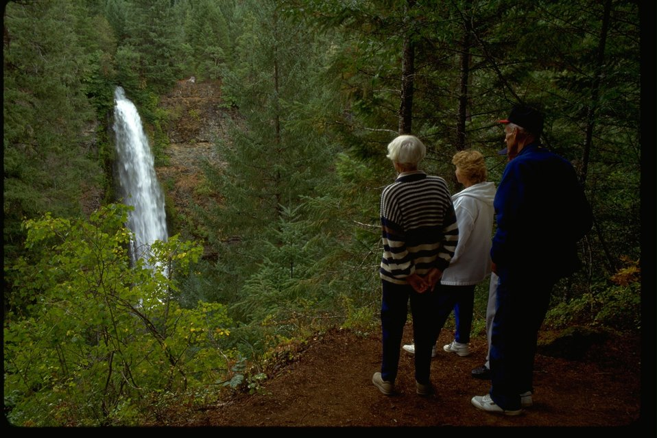 Onlookers take in the beauty of the Mill Creek Falls on the Upper Rogue.