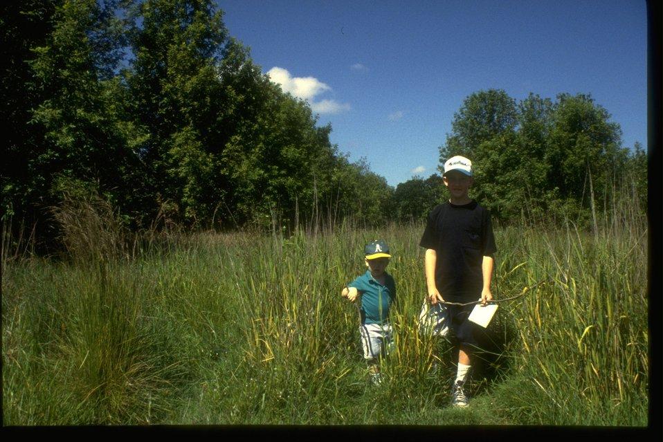 Children explore the West Eugene Wetlands Project Site.