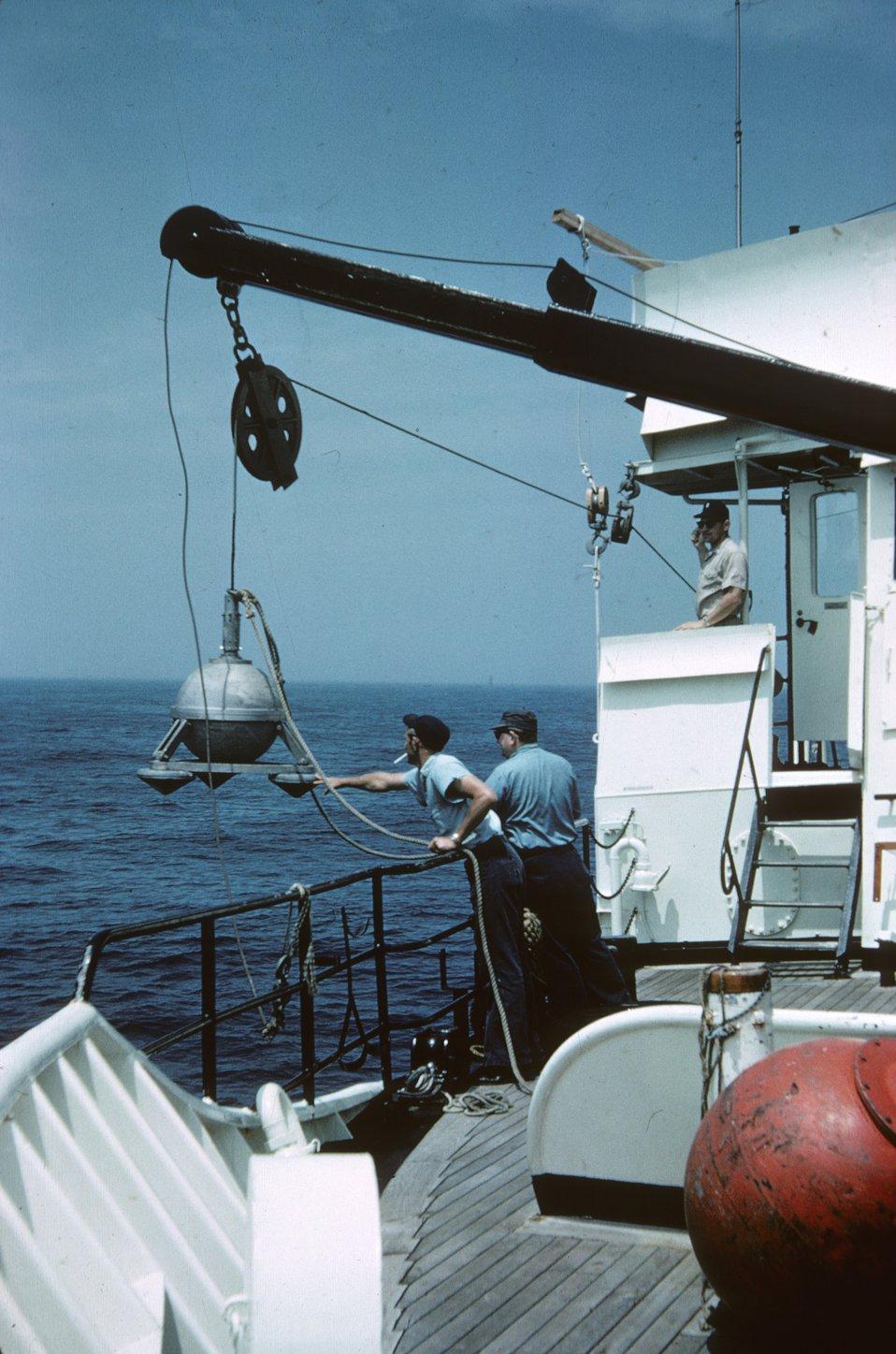 Deploying a bottom-mounted gravity meter.
