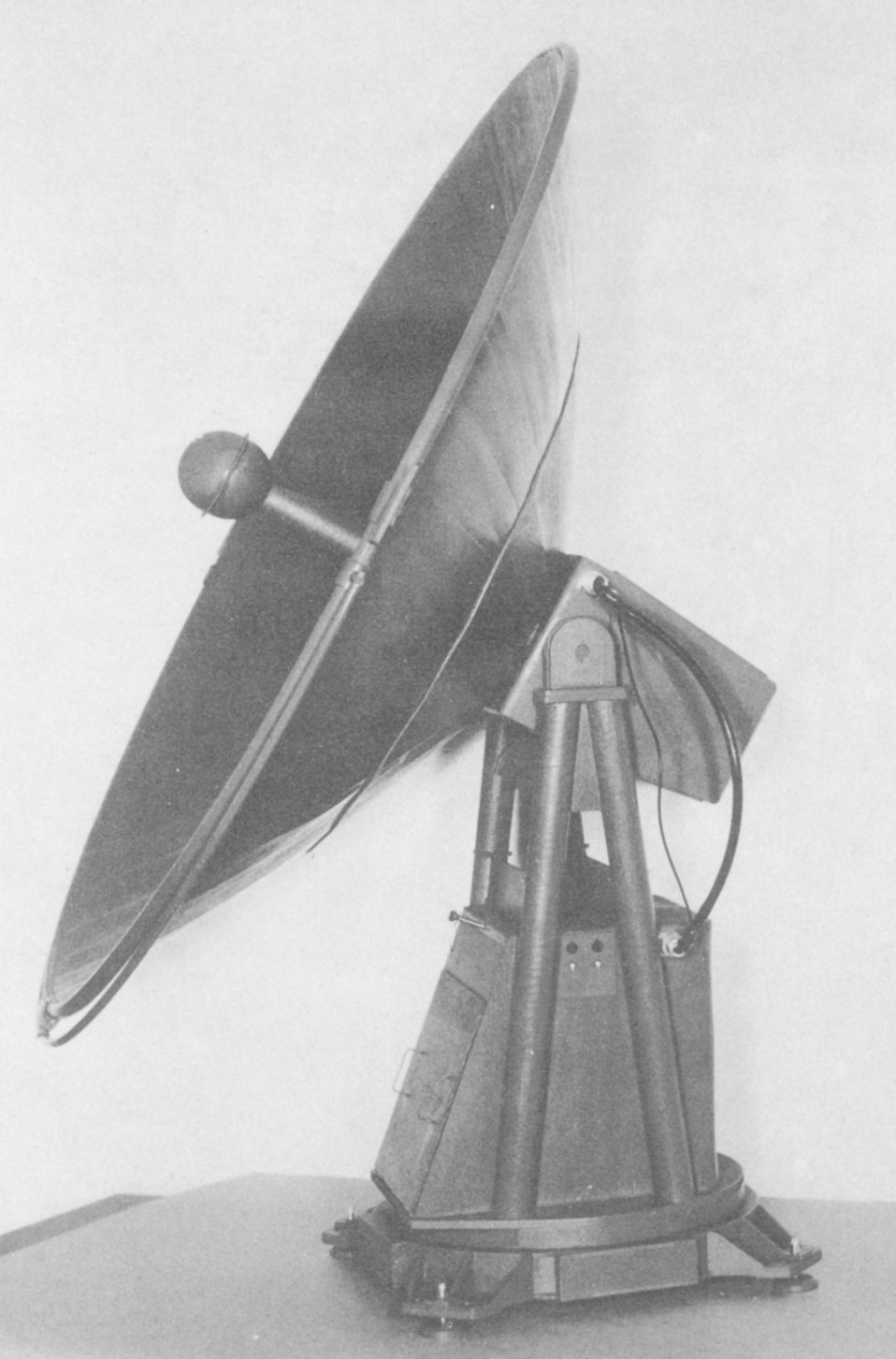 Scale model of new radiotheodolites meant to replace the SCR-658 bed-spring type for tracking balloon carried radiosondes.