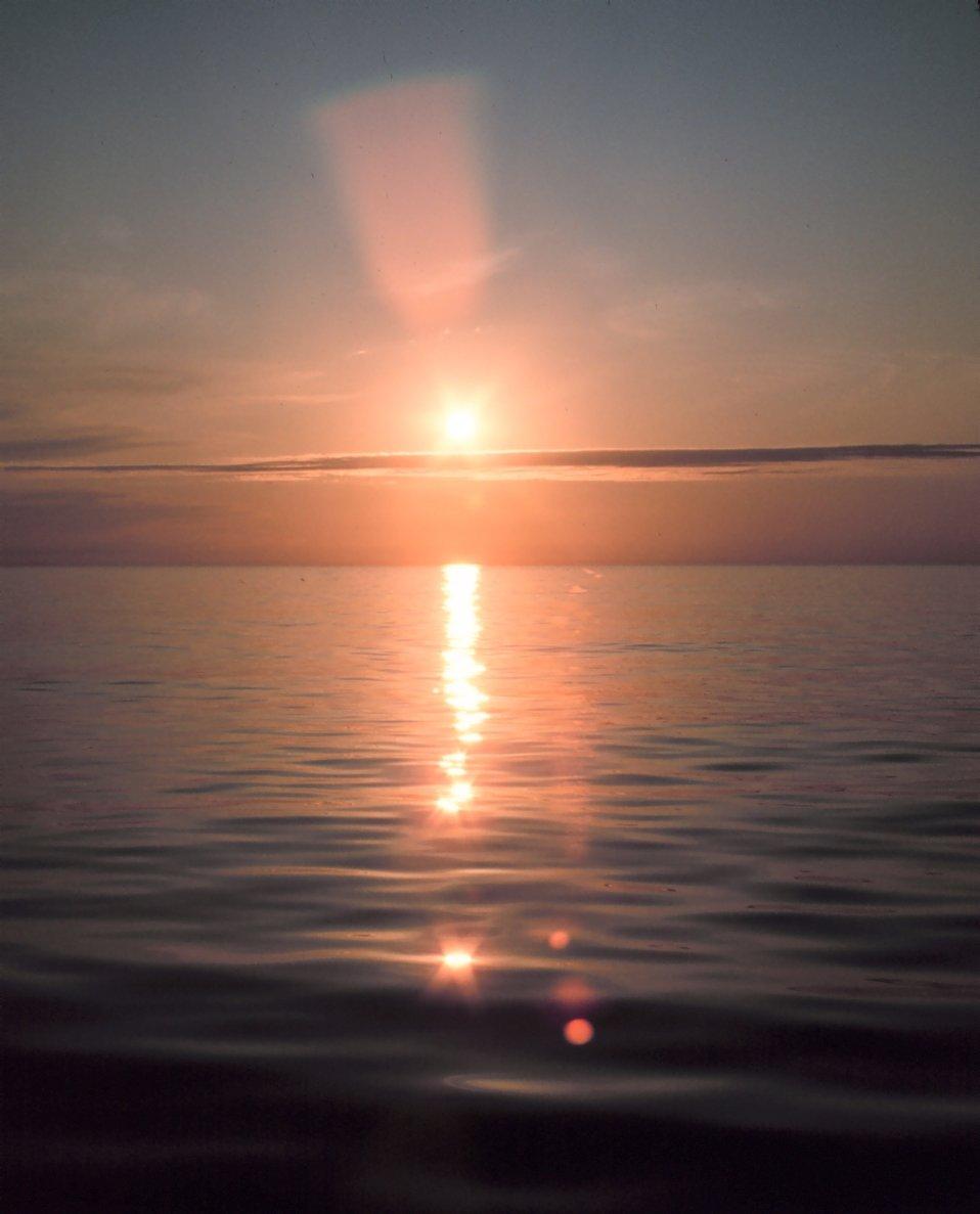 Brilliant reflection of sunlight off a calm ocean.