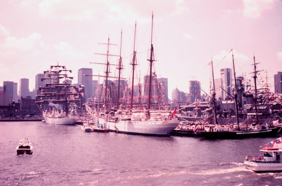 Tall ships tied up in New York Harbor