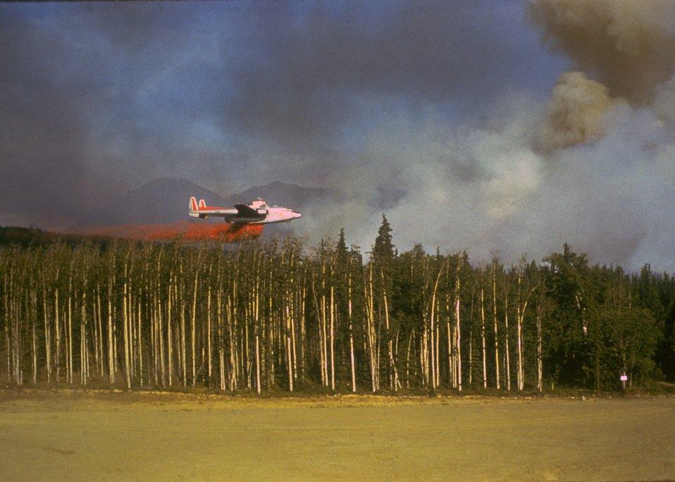 Fire retardant drop from an aircraft.