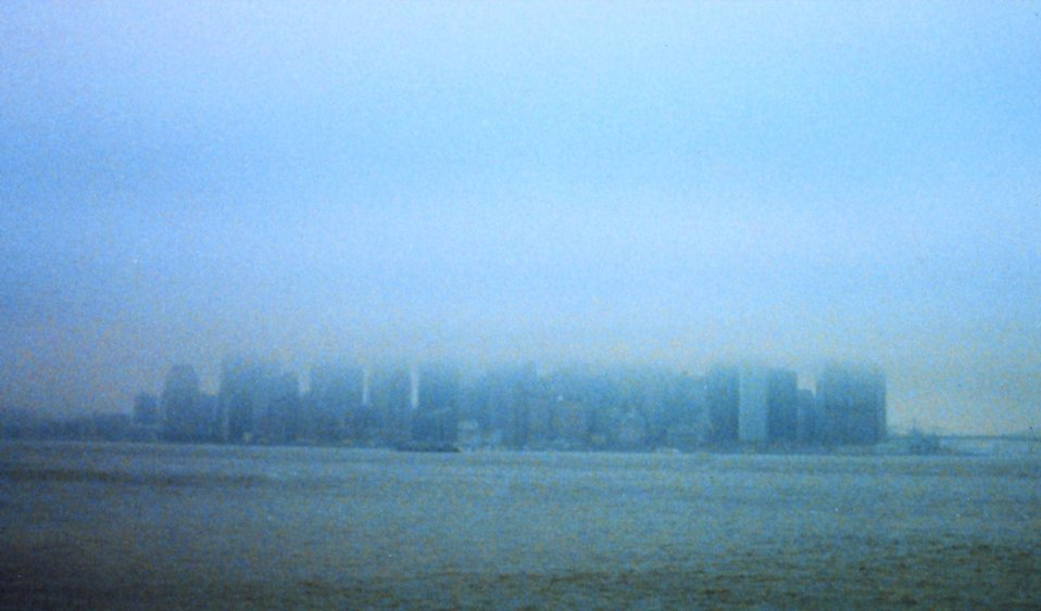 Manhattan skyline truncated by fog