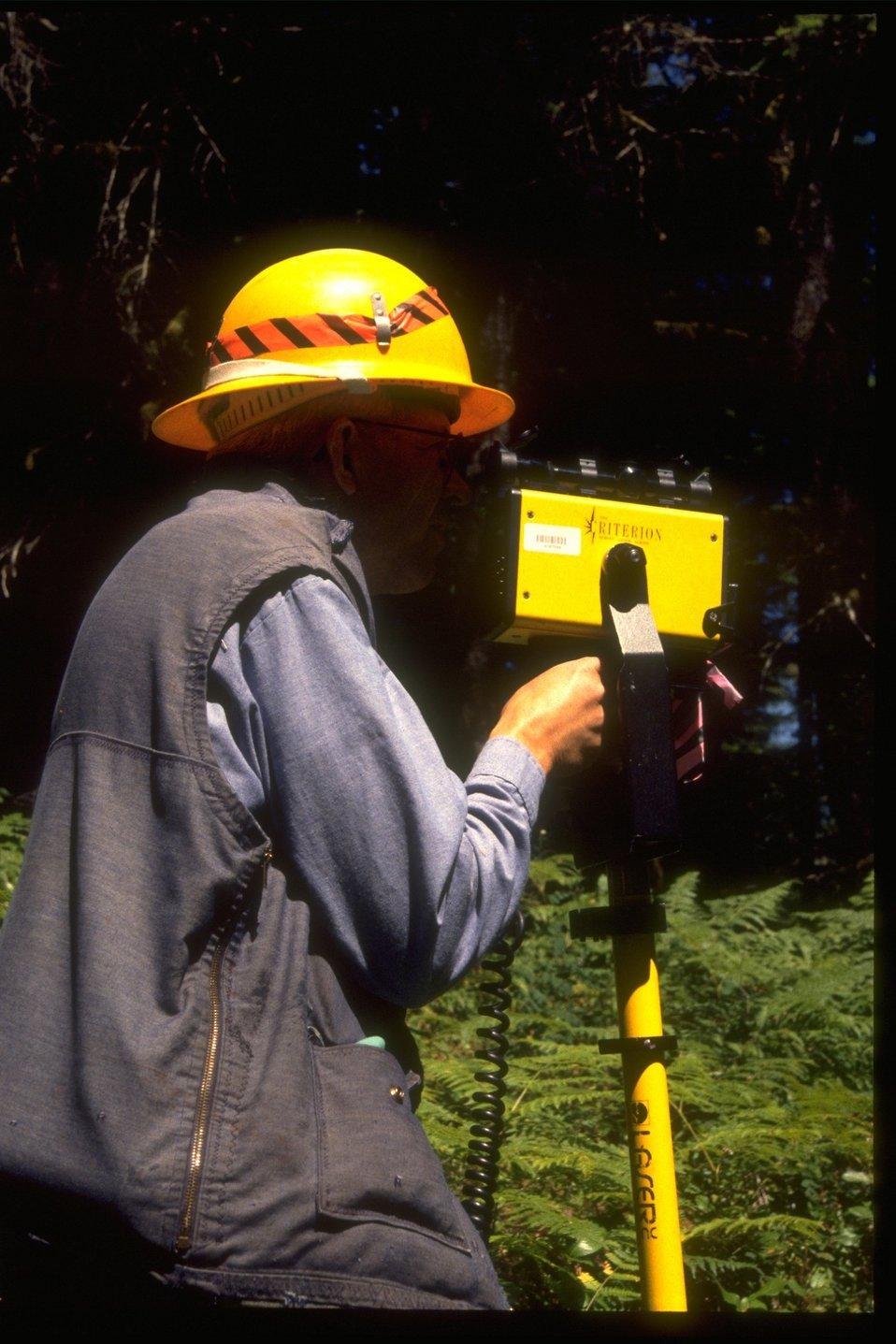 Forester uses radar gun to survey.