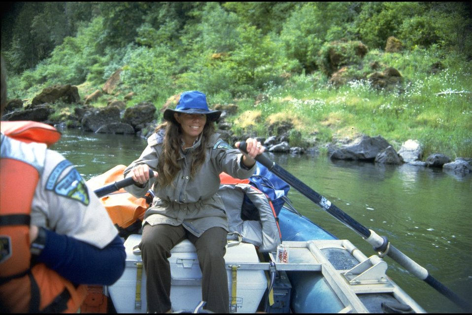 Rogue River, wild section; Louise Austermuehle, BLM River Staff, rowing on maintenance trip.