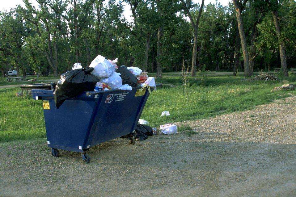 A very full trash dumpster at Kipp Recreation Site