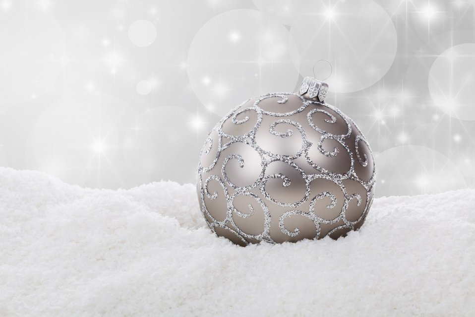 Silver christmas ball in snow