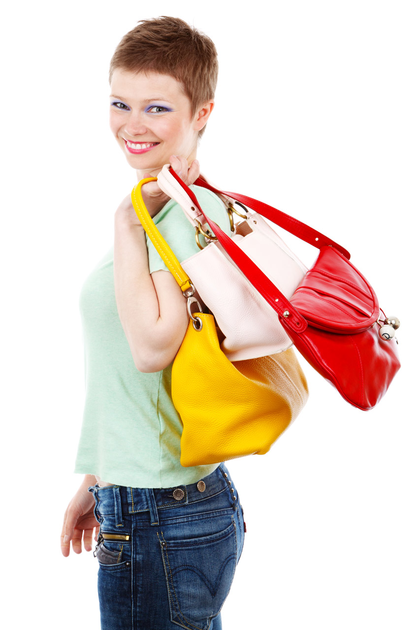Smiling woman with bags