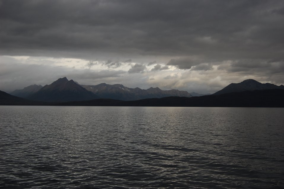 Mountains, clouds, and sunlight in the Strait of Magellan.