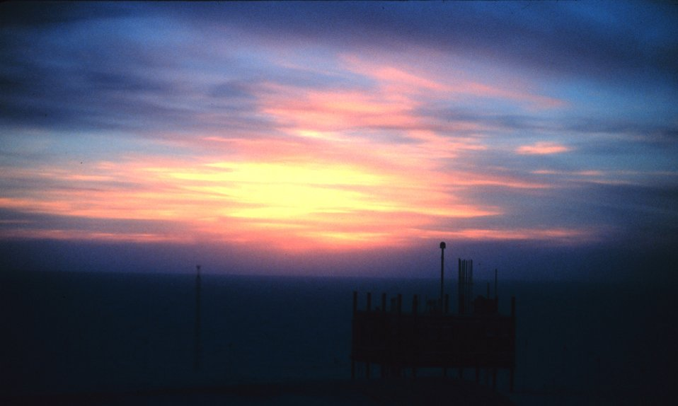 Instruments on the Clean Air Facility silhouetted against the sunset