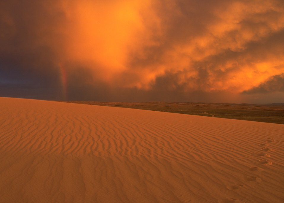 Passing storm at sunset over OHV Sand Dunes Area, Rock Springs Field Office.