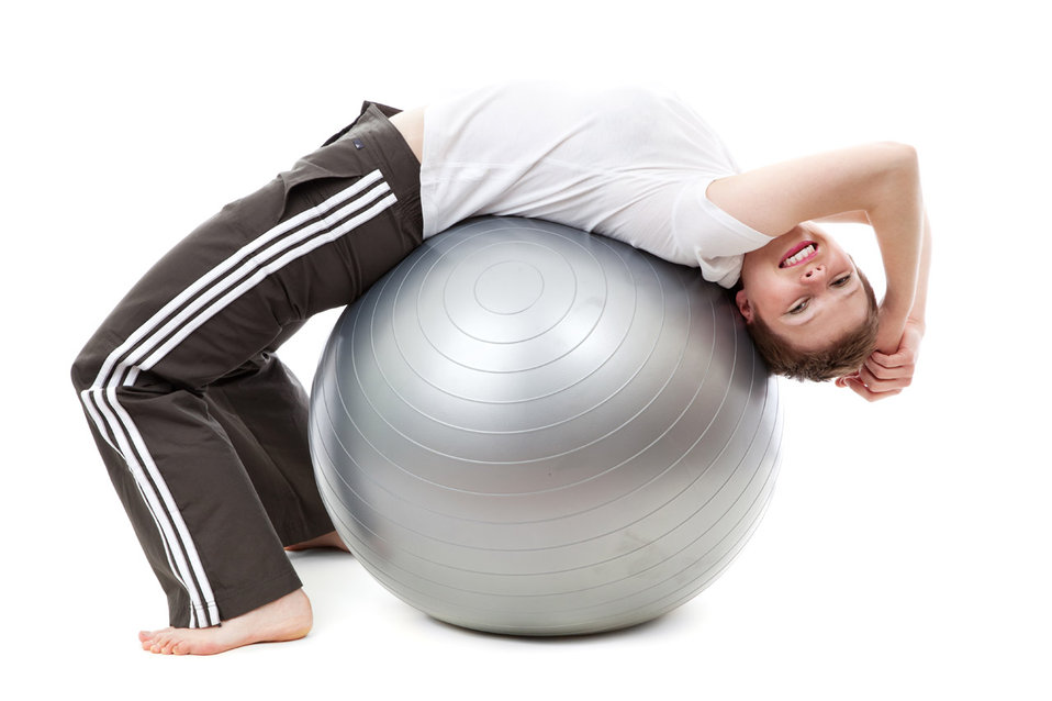 Exercising on a gym ball