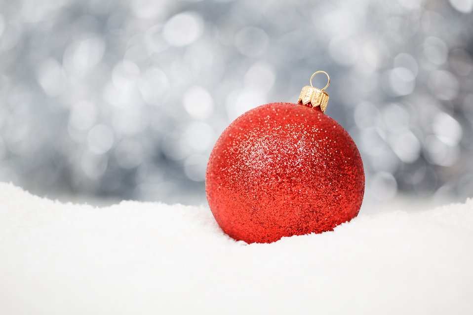 Red christmas ball in snow