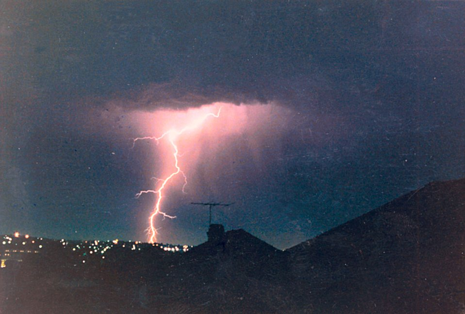 Many of Mr. Lear's lightning photographs are taken from the roof of his home. He has an array of six cameras that can be activated simultaneously in order to capture lightning images.  These six cameras span the horizon.  Mr. Lear is a welder by trade a