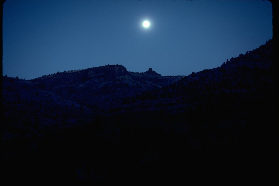Moon shining over Chimney Rock.