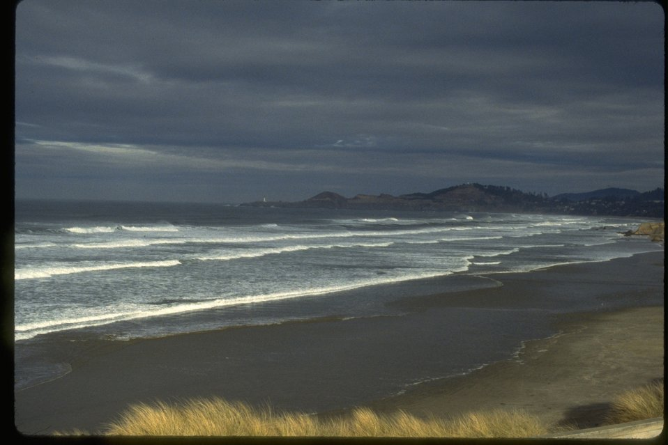A distant picture taken of Yaquina Head ONA, taken from Nile Beach.
