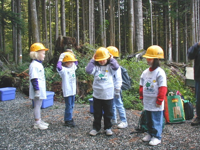 A troop of Brownies from Portland, OR try on their hard hats